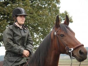 Julia riding a horse